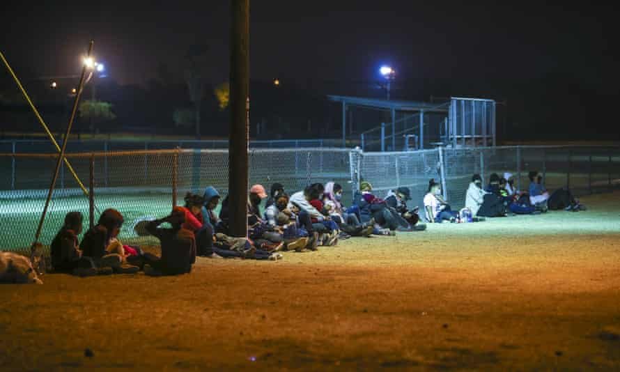 Migrants wait at the border after crossing the Rio Grande. White House spokeswoman Jen Psaki said 'the objective is to make it more difficult to make the journey'.