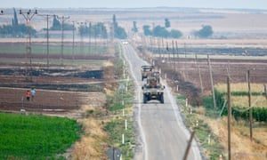 Turkish soldiers patrol the Syrian border