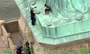 Video frame provided by the New York City police department, as members of the emergency service unit work to safely remove Therese Okoumou from the Statue of Liberty.