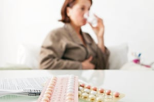 Woman taking the pill.