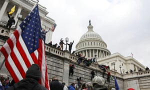 Trump supporters climb the walls of the US Capitol on 6 January.