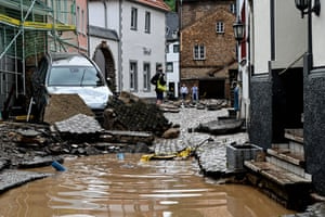 A damaged road after flooding in Bad Münstereifel, Germany