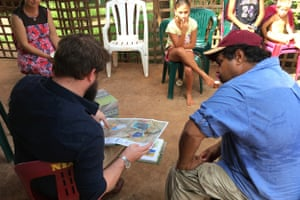 David Morris takes a Borroloola resident through the environmental impact statement by Glencore proposing to expand its mining operation