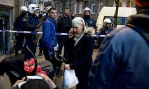 Locals stuck outside a security perimeter around Rue de la Carpe in Molenbeek-Saint-Jean in Brussels last week.
