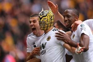 The Mexican celebrates with a Wolves Lucha Libre mask.