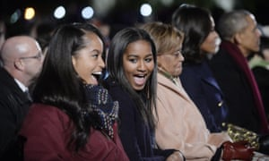 Michelle Obama and President Barack Obama attend the national Christmas tree lighting ceremony