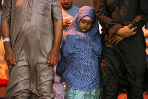 A young girl performing prayers.