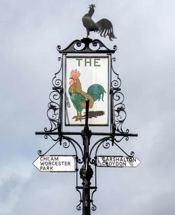 The Cock sign on Sutton High Street.