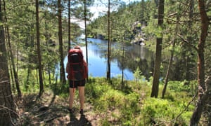 backpacker by one of the many lakes on the Dalsland Pilgrim Trail