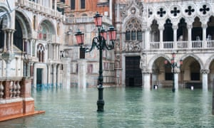 St Mark's Square is submerged by more than one metre of water