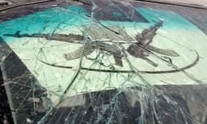 Boko Haram logo on cracked windscreen