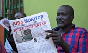 A man reads a copy of the Juba Monitor