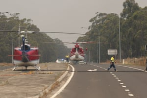 The Princess Highway at the Sussex Inlet intersection becomes a refuelling point for water-bombing helicopters fighting the Currowan fire south of Nowra.