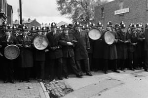 Police in Winson Green, Birmingham, confront a protest against a National Front march