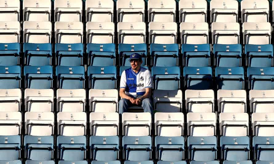 A lone Bristol Rovers fan sits at the Checkatrade Trophy game with Reading U23s