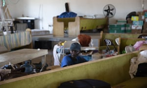 A man rests at the Full Gospel church in Sand Banks, 9 September 2019 in Great Abaco Island, Bahamas. The Haitians that have stayed struggle to survive with little help from foreign aid agencies.
