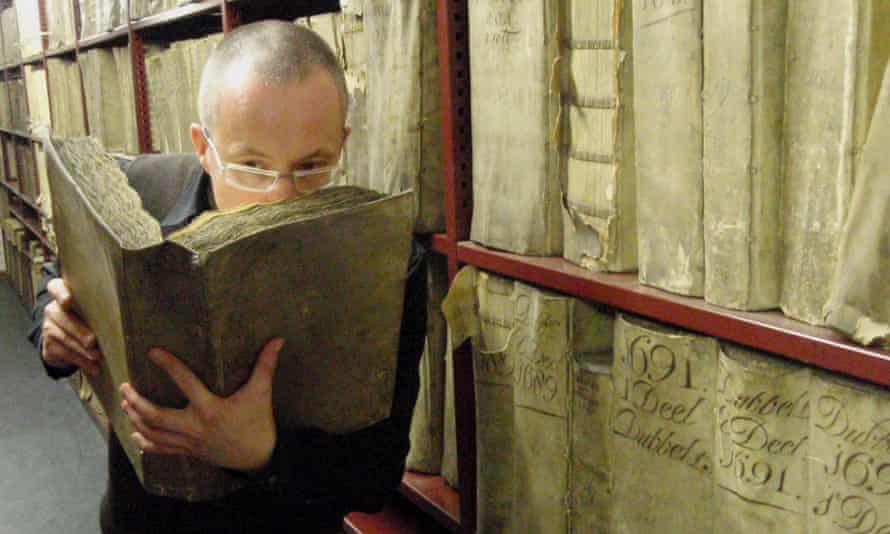 Prof Matija Strlic smells a historical book in the National Archives of the Netherlands.