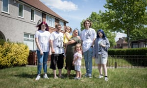 The Rivers family outside their Dagenham home, from left: Ruby, 14, Lee, Harlee-Rose, three, Kelly, Scarlett, five, Martin, 19, and Bethany, 14.