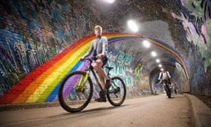 Cyclists pass underneath the rainbow mural in Colinton tunnel, Edinburgh, as the UK continues in lockdown.