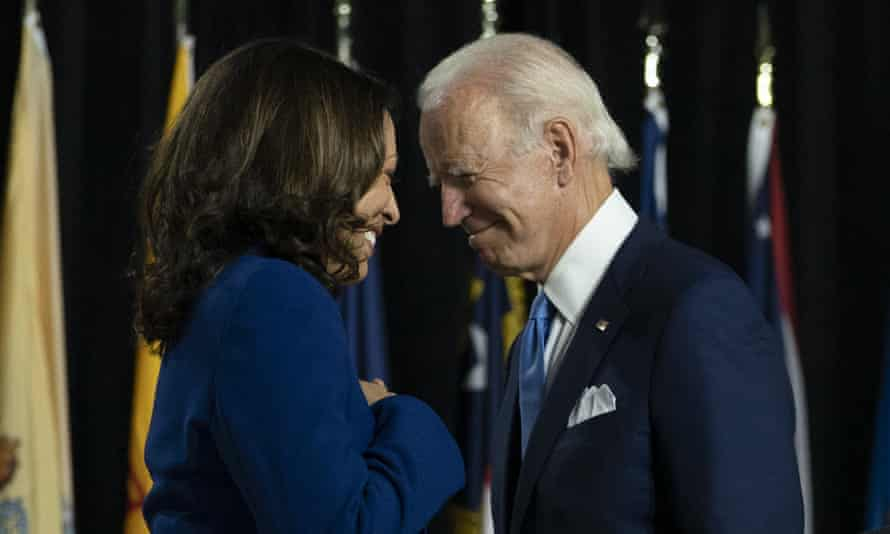 Joe Biden,Kamala Harris<br>Democratic presidential candidate former Vice President Joe Biden and his running mate Sen. Kamala Harris, D-Calif., pass each other as Harris moves to the podium to speak during a campaign event at Alexis Dupont High School in Wilmington, Del., Wednesday, Aug. 12, 2020. (AP Photo/Carolyn Kaster)