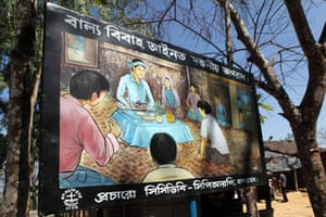 A billboard in Bandarban, Bangladesh, informs people child marriage is illegal and a serious offence.