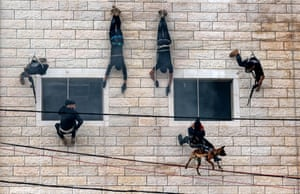 Gaza City Palestinian Hamas security forces rappel along the wall of a building as they show off their skills during a police graduation ceremony