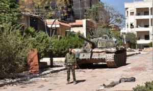 A Syrian pro-government soldier, south of al-Hamdaniya, in east Aleppo.