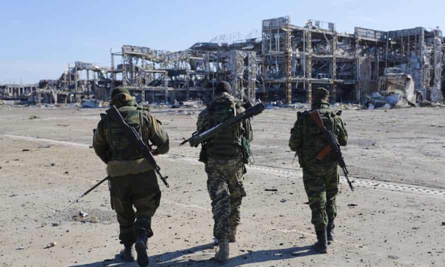 Pro-Russia rebels walk towards the destroyed Donetsk international airport last October.