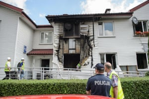 Lublin, Poland Police inspect a damaged house after a gas explosion injured seven people