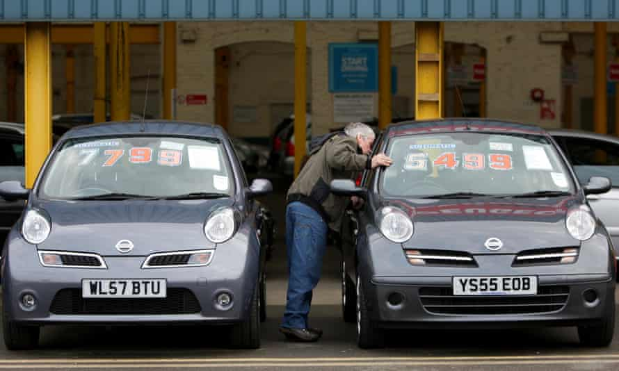 A customer looks at the cars on sale at Cargiant
