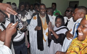 Mauritania anti-slavery activist Biram Ould Dah Ould Abeid is welcomed by supporters as he walks out of jail after the country's supreme court downgraded the crimes they were convicted of last year and ordered their release, on May 17, 2016 in Nouakchott.