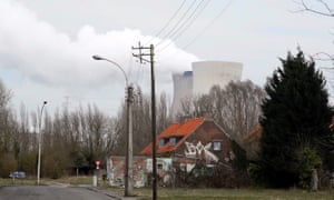 Steam rises from the cooling towers of the Doel nuclear power plant.