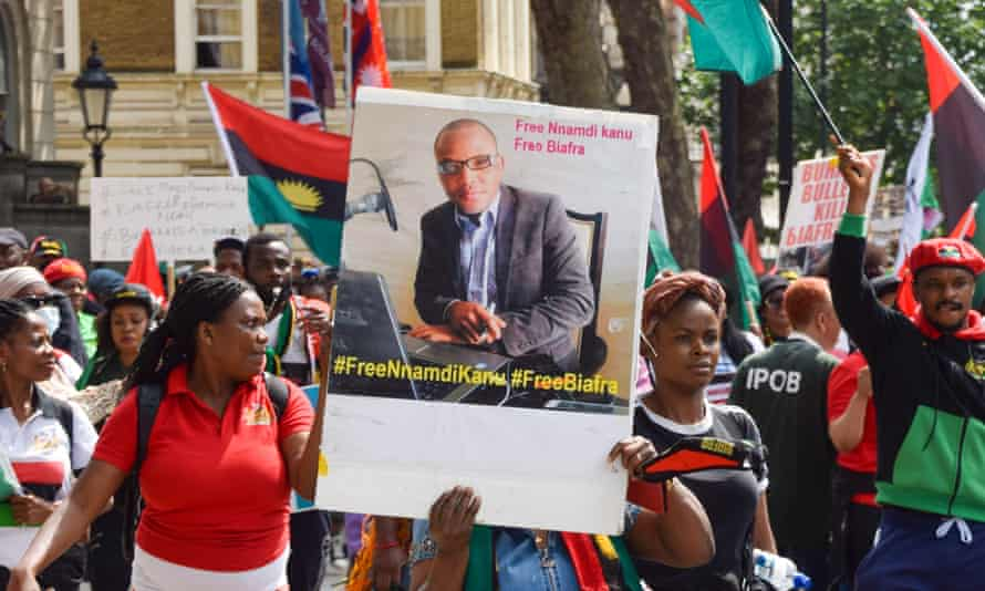 A demonstrator holds a picture of Nnamdi Kanu outside Downing Street during a recent Free Biafra protest calling for his release.