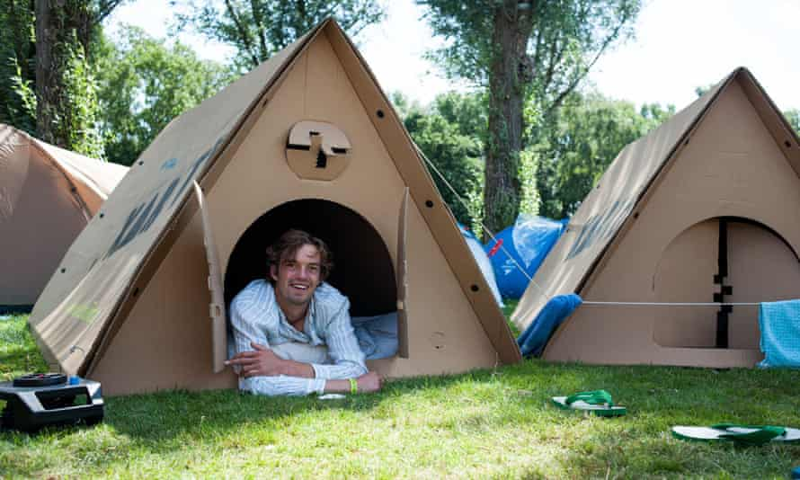 man in a cardboard tent