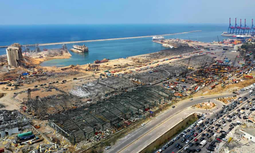 An aerial view shows the port of Beirut on 7 August 2020, three days after the huge explosion. The Lebanese Red Cross says dozens of port workers may still be buried under debris.