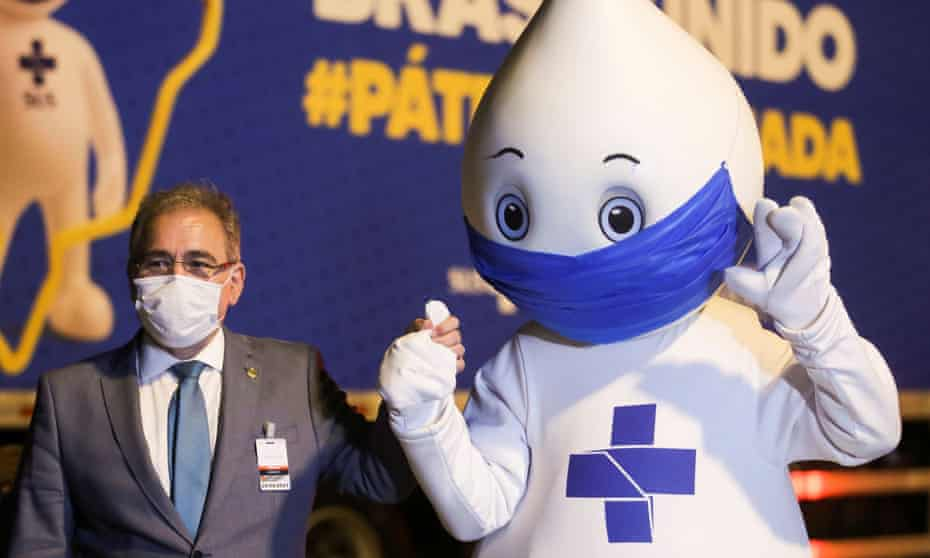 Brazil's health minister, Marcelo Queiroga, and the country's vaccination campaign mascot Zé Gotinha celebrate as Pfizer/BioNTech Covid jabs arrive at Viracopos airport near São Paulo.