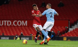 Manchester United's Marcus Rashford is fouled by Manchester City's Kyle Walker in the penalty area.