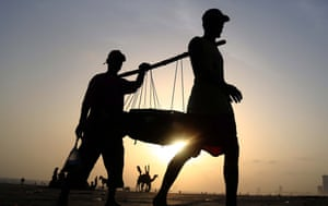 Karachi, PakistanFishermen collect fish at the beach in Pakistan