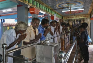 Hindu devotees participate in a special prayer performed for the success of Sen. Kamala Harris at a temple in Thulasendrapuram.