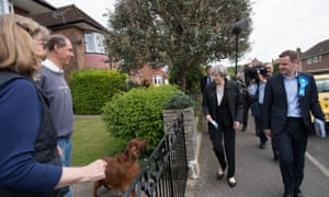 Theresa May with Conservative candidate Paul Holmes (right) during a visit to Southampton