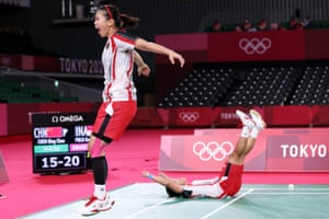 Indonesia's Greysia Polii and Apriyani Rahayu celebrate winning the badminton women's doubles gold medal match against China's Chen Qingchen and Jia Yifan.