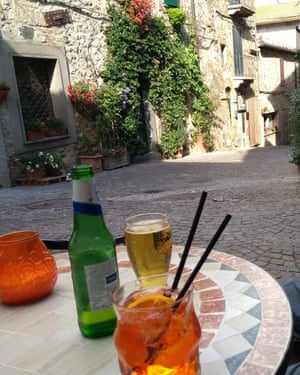 Drinks outside bar in Allerone, with village street