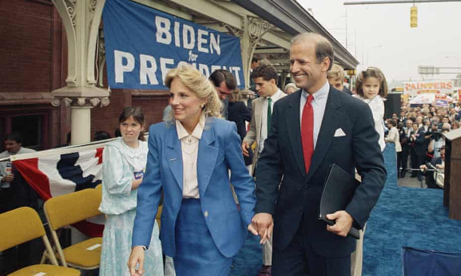 Joe Biden walks with his wife, Jill, after announcing his candidacy for president 9 June 1987, in Wilmington, Delaware.