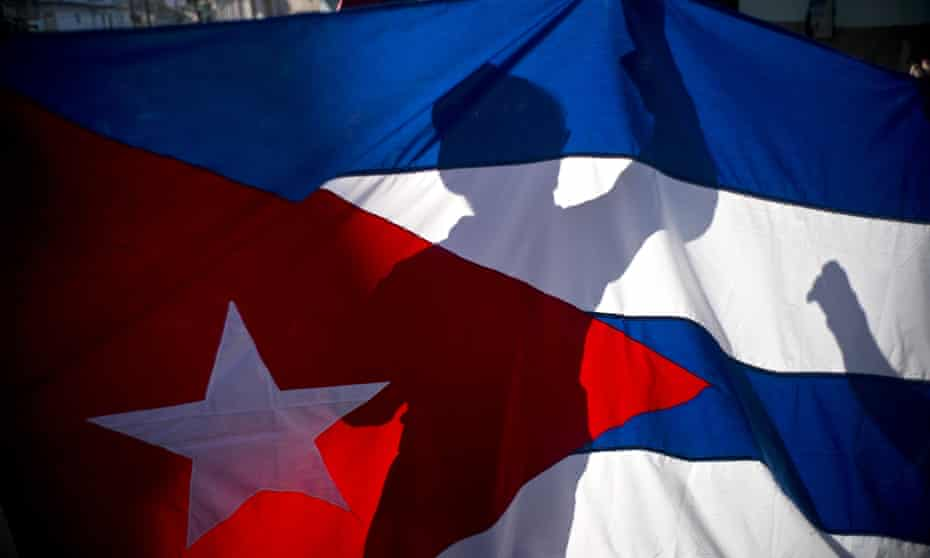 A child holds a Cuban flag marking the 59th anniversary of the arrival of Fidel Castro and his rebel army on the outskirts of Havana in January.