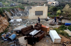 Palestinians search through the remains of a house after Israeli forces demolished it in the village of Al-Walaja near Bethlehem in the Israeli-occupied West Bank.