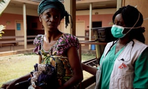 """Hortense (left) talks with Dr Gertrude Komoyo at the Centre Hospitalier Universitaire Communautaire (CHUC) of Bangui, where MSF runs the advanced HIV unit. Hortense's daughter is at the hospital since a week. She got HIV when, aged 3, she suffered from anemia and was transfused two bags of blood. She was tested and started her treatment when 9-years-old, with the support of her mother. """"She takes the medication, so she is still there,"""" says Hortense. """"This virus, we can't ignore it, it was not her fault. Now that she has it, we have to live3 with it. If we tried to hide it, she wouldn't take her medication normally and would catch other diseases. So, what else can we do?"""" Hortense's daughter, Fatoumatou, has two child, a 5-years-old girl who is seronegative, and a young baby boy who is under treatment until his 18 months."""