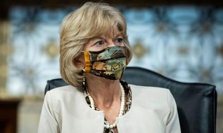 Lisa Murkowski listens during a Senate committee hearing in Washington.
