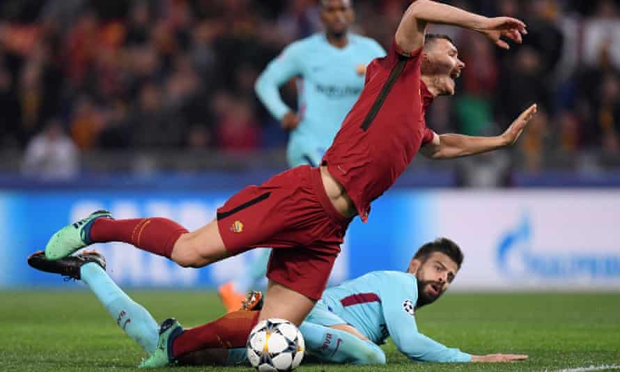 Gerard Piqué brings down Edin Dzeko for the penalty from which Roma went 2-0 up against Barcelona