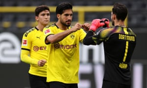 Goalscorer Emre Can and Borussia Dortmund keeper Roman Burki celebrate the win.