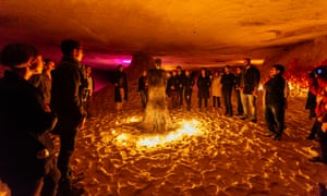 Guests gather at an exhibition of work by the occult artist Léonard Condemine.